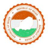 De kaart en de vlag van Niger in uitstekende rubberzegel Stock Foto