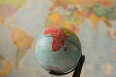 De kaart van Afrika op een bol Stock Foto