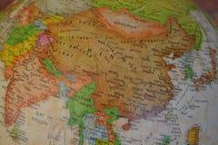 De kaart van China op de bol Stock Afbeeldingen