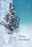 De kaart van de Kerstmisgroet in blauw en zilveren, titel Royalty-vrije Stock Foto