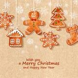 De kaart van de Kerstmisgroet met peperkoekkoekjes stock afbeeldingen