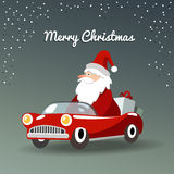 De kaart van de Kerstmisgroet met Santa Claus, retro sportwagen Stock Foto's