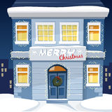 De kaart van de Kerstmisgroet met verlicht oud huis en sneeuw stedelijk landschap, Royalty-vrije Stock Afbeeldingen