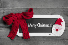 De kaart van de Kerstmisgroet in rood, wit en grijs - tekst: vrolijke chr Stock Afbeelding