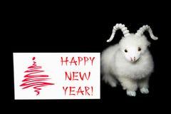 De kaart van de nieuwjaargroet of prentbriefkaar met geit Stock Afbeelding