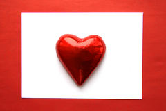 De kaart van de valentijnskaart met hart gevormd suikergoed Royalty-vrije Stock Foto