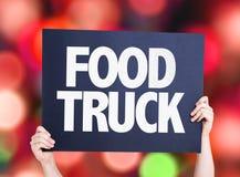 De kaart van de voedselvrachtwagen met bokehachtergrond Stock Fotografie