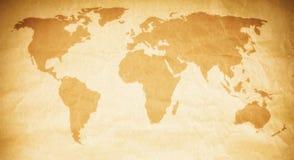 De kaart van de wereld op document textuur Stock Foto