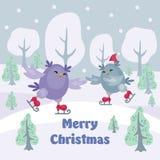 De kaart van de Kerstmisgroet met uilen Stock Foto's