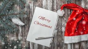 De kaart van de Kerstmisgroet op oude houten achtergrond met ruimte waar u een bericht voor Kerstman kunt verlaten Stock Foto's