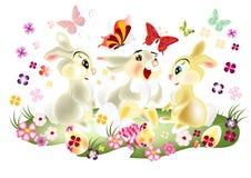De kaart van Pasen met drie mooie beeldverhaalhazen zit Stock Foto