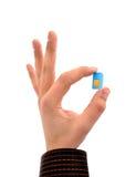 De kaart van Sim in uw hand stock foto
