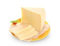 De kaas op gele plaat isoleerde witte achtergrond royalty-vrije stock fotografie