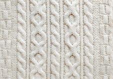 De kabel breit stoffenachtergrond Royalty-vrije Stock Afbeeldingen