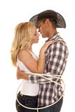 De kabel van het cowboypaar rond hen gezicht elkaar royalty-vrije stock afbeelding