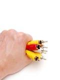 De kabel van Varicoloured in een hand stock afbeelding