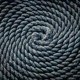 De kabel voor de boot in de vorm van een spiraal wordt gelegd die Achtergrond royalty-vrije stock afbeeldingen