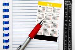 De kalender en de kantoorbehoeften van de zak Royalty-vrije Stock Foto