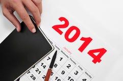 de kalender en het notitieboekje van 2014 Stock Afbeeldingen
