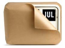 De kalender van de het bureauklok van juli die omhoog in bruine pap wordt verpakt Stock Foto's