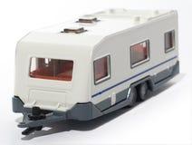 De kampeerautoaanhangwagen van het stuk speelgoed Stock Foto's