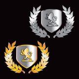 De kamschilden van de leeuw in goud en zilver Royalty-vrije Stock Afbeelding