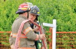 De Kapitein van de brandvechter en Bemanningslid royalty-vrije stock afbeeldingen