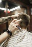 De kapper is het gel van het oorzakenhaar royalty-vrije stock foto's