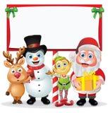 De Karakters van Kerstmis rond een Teken Stock Foto's