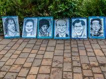 De karikaturen van de straatkunstenaar stock afbeelding