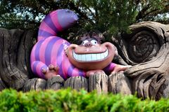 De kat van Cheshire van het magische verhaal van Lewis Carroll ` s stock afbeelding