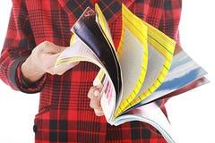 De keerder van de tijdschriftpagina stock foto