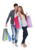 De kerel en gal brengen het winkelen zakken Stock Foto