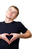 De kerel toont hartteken royalty-vrije stock afbeelding