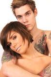 De Kerel van de tatoegering met Meisje Royalty-vrije Stock Fotografie