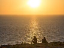 De Kerels van de Zonsondergang stock foto