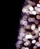 De kerstboom steekt bokeh aan Stock Foto