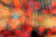 De kerstboom steekt kleurrijke bokehachtergrond aan Stock Foto's