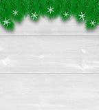 De kerstboom vertakt zich achtergrond op lichte raad Stock Afbeelding