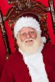 De Kerstman als zijn voorzitter Stock Afbeelding