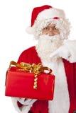 De Kerstman die op de giftdoos van Kerstmis richt Royalty-vrije Stock Afbeelding
