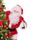 De Kerstman door de duim van de Kerstmisboom omhoog. Stock Afbeelding