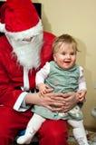 De Kerstman en baby Royalty-vrije Stock Afbeeldingen