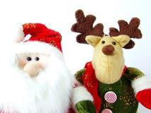 De Kerstman en het Rendier van Kerstmis van de pluche stock afbeelding