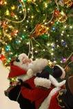 De Kerstman en Kerstmisboom Stock Afbeeldingen