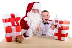 De Kerstman en kind Royalty-vrije Stock Afbeelding
