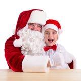 De Kerstman en kind Stock Afbeeldingen