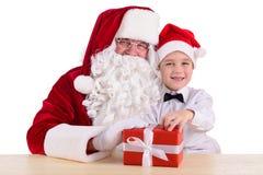 De Kerstman en kind Royalty-vrije Stock Afbeeldingen