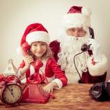 De Kerstman en kind Royalty-vrije Stock Foto