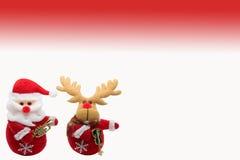 De Kerstman en teugelherten Royalty-vrije Stock Foto's